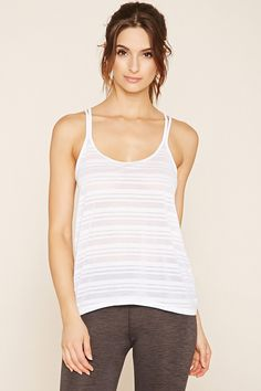 An athletic shadow stripe knit cami with a scoop neckline and crisscross back straps.