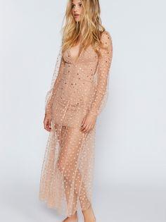 All That Glitters Tulle Maxi Dress | Beautiful sheer tulle maxi dress featuring shimmering stars throughout.    * Nude lining   * Open back design   * V-neckline   * Hidden back zipper closure   * Adjustable straps