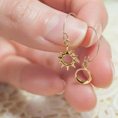 Lani Golden Sun and Eclipse Earrings by ileava jewelry. One of the phenomenal astronomical event is the solar eclipse. These pair of 18kt yellow gold dangling earrings represent the solar eclipse with the sun and the moon.