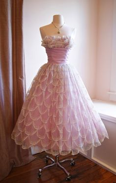 A pink 1950s dress. They don't make them like this any more (sigh).