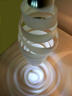 Whirl is a series of acrylic pendant and table lamps by David Boo inspired by a whirlpool.