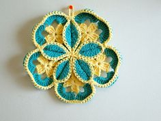 This is called Starburst Hot Pad. you could use it as a pot holder also if it is double sided in cotton yarn. Don't use acrylic yarn it will burn if something is hot. Potholders should be done in cotton yarn. There is also a You Tube Video Tutorial on how to do this. RIGHT click and click on open link in new tab http://www.youtube.com/watch?v=pG3330VMNGY