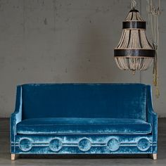 velvet sofa - love the nail head details.