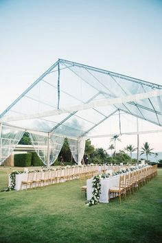 outdoor wedding reception under a clear tent