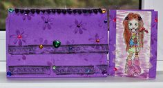 a wallet and girl card in purple