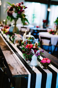 This black and white stripe table runner is a seriously eye-catching way to show off the array of colorful flowers | Whimsical Ranch Wedding at Pecan Springs Ranch in Austin, TX | Plannner: Pure Love Style | Images by: Al Gawlik Photography and Sarah Goss Photography | Flowers by: The Flower Girl and Pure Love Style