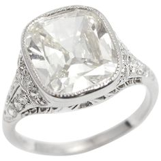 Edwardian 4.38 Carat Cushion Shape Diamond Platinum Ring  | From a unique collection of vintage engagement rings at https://www.1stdibs.com/jewelry/rings/engagement-rings/