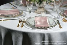 White Panama tablecloth with Lamour Matte Satin Peach napkin. Pair it with gold accented tableware to complete the look.