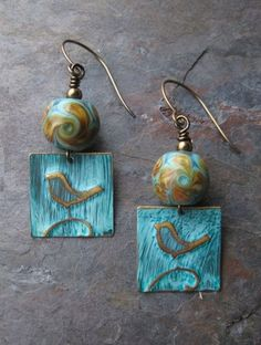 Items similar to Beloved Bird Earrings on Etsy : Kristy did a fabulous job picking up the colors from the lampwork beads in her embossed and ink Vintaj brass blanks - love :) Ceramic Jewelry, Copper Jewelry, Clay Jewelry, Jewelry Crafts, Beaded Jewelry, Jewelry Ideas, Earrings Handmade, Handmade Jewelry, Do It Yourself Jewelry