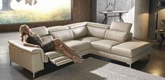Stylish leather corner modular lounge with electric-recliner, terminal and three adjustable headrests.