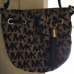 20fd3cb97fb Michael Kors cross body bag Authentic MK bag with a pocket inside and  outside. Great