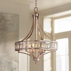 Crystal clear glass rods glisten against the silver leaf finish of this transitional chandelier.