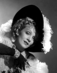 Marlene again.  Hat + curls + feathers = win.