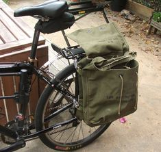 I bought an old army backpack at a flea market for $5 and attached it to my bike rack. I wanted it set up so that the bag could easily be removed and carried around as a backpack when I parked my bike. I was inspired by this website:http://web.archive.org/web/20041020064156/http://www.twowheelfetish.com/Ezine4/diypanniers.htmlI was originally going to use the same method of making an internal dowel frame to keep the backpack rigid. But my backpack luckily had 8 metal rings on the sides that…