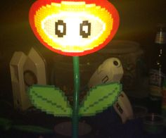 A Mario inspired clip-on LED desk lamp! A simple lamp made from simple materials (perler beads, LED desk lamp, hot glue, etc). You to can have the power-up you know and love illuminate your craft areas!