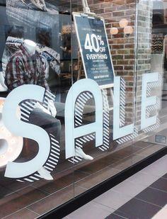 Sale window display in White Oaks Mall