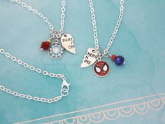 """If you love Tony Stark and his new """"adopted"""" son and/or protégé Peter Parker, you'll love this necklace set! Dedicated to Spider Man and Iron Man, this Marvel friendship necklace set is perfect for you and your best friend. First Iron Man, Spiderman, Marvel E Dc, Marvel Universe, Bff Necklaces, Iron Spider, Friendship Necklaces, Cute Jewelry, Bohemian Jewelry"""