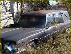 This abandoned hearse sat rotting behind a funeral home for 7 years.