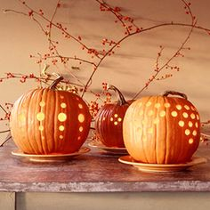Drilling holes instead of carving faces.  An elegant alternative to the regular Halloween Pumpkins!
