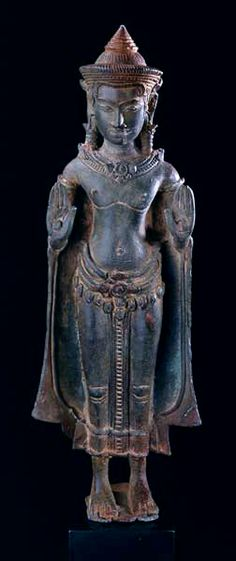 Khmer Bronze Sculpture of the Buddha Origin: Cambodia Circa: 12 th Century AD to 13 th Century AD