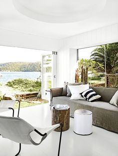 "A waterside family home on Sydney's Northern Beaches:The living area soaks up views of the water through banks of glass doors and windows. The handiwork of interior stylist Pamela Makin – ""casual, not structured, laid-back and minimal"" – is achieved by layering African tribal elements and inspired re-purposed finds, such as driftwood, shells and bones."