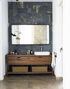 Looking for bathroom ideas? This white modern bathroom uses slate tiles and a bespoke wooden cabinet to create a chic but natural look. Find more bathroom ideas at theroomedit.com