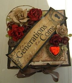 Altered book with crimson and off-white roses, brown ribbon and a beautiful old-world-styled title...simply stunning.