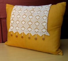 Antique crochet and vintage buttons on a mustard linen pillow by vintagedesignstudio: