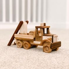 This sturdy, well-made wooden toy is a classic loved by both little girls and boys alike. It is handmade of safe materials and finished with linseed oil. The surface is smooth and won't harm your children. It's perfect for all ages and makes a wonderful gift. We can personalize it by engraving your child's name across the front. This environmentally safe toy is durable to last through the generations.  Safety: Our wood toys are created to be safe and natural toys for children and babies. No…