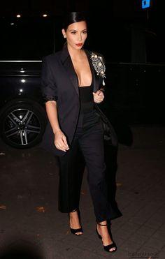 Kim Kardashian flaunts a plunging neckline at the CR Fashion Book #5 Paris Launch Party