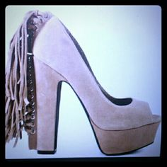 BEBE SUEDE FRINGE PUMPS Size 7.5  Beige Suede Heels with Finges on back ... has a small red dot on front see on picture 3 on the right shoe ... very small not noticeable unless someone is starting directly at your foot , right on you :) ...Other then that Very good condition ...Fringe is in ...Gorgeous Heels ... Just make an offer :) bebe Shoes Heels