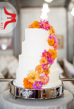 Pinks & yellows accompany orange on this fall wedding cake decor.