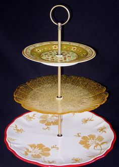 """Three Tier Stand, Jewelry Stand, Vanity Stand, Cake Plate, Tray, Mismatched Plates, Cupcake Stand, Dessert, Appetizer, Tidbit, Vintage, Antique. Vintage three tiered plate stand. Made with antique and vintage plates and new stand hardware. Top plate is 6.5"""", the Middle plate is 8.5"""", and the bottom plate in 11"""". Total tray height when assembled is 13"""" to the top of the handle. This is a handmade, one of a kind item! I buy the vintage plates at estate sales so there may be some light wear...."""