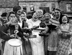 Housewives toss their pancakes at the start of the Olney Pancake Race 2 March 1949.  Eating pancakes on Shrove Tuesday or Pancake Day, is an ancient tradition. It is the day before Lent; the start of the traditional fast. By giving up dairy products, people marked Jesus' 40 days and nights in the wilderness. So on Shrove Tuesday, stores of dairy products were used up on pancake day.
