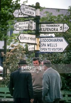 02-03 Three local men have a conversation at an intersection in... #lisdoonvarna: 02-03 Three local men have a conversation… #lisdoonvarna