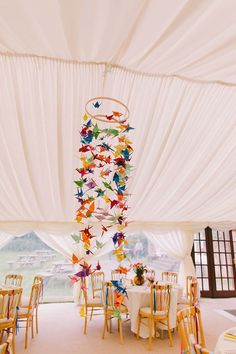 Colourful paper cranes for a Carnival Inspired Wedding   Photography by http://www.pnmweddings.com/