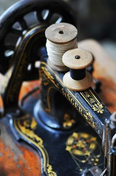 Vintage sewing machine and spools of thread. :)