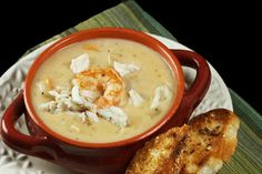 Shrimp & Crab Chowder - a creamy and delicious chowder packed with jumbo lump crab meat, gulf shrimp and vegetables. Serve it up with a loaf of crusty bread for a perfect meal!