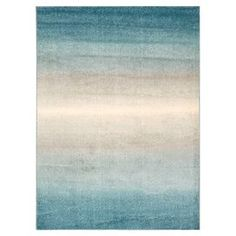 Anchor your living room decor or define a space in your master suite with this eye-catching rug, showcasing an ombre motif in blue.  Product: RugConstruction Material: PolyesterColor: Blue ombreFeatures:  Power-loomed Note: Please be aware that actual colors may vary from those shown on your screen. Accent rugs may also not show the entire pattern that the corresponding area rugs have.Cleaning and Care: Professional cleaning recommended