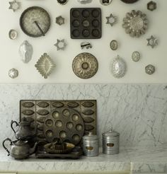 I love a good collection. Well-displayed, anything can look decorative - like these vintage tins on the wall
