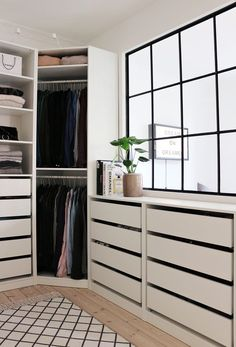 The clean white spaces create a nice pattern with the black mullions, patterned rug, and drawer reveals.