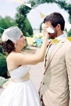 Sweet photo of bride wiping away her groom's tears