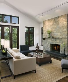 vaulted living room with rear access