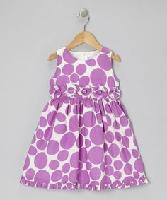 Crafted out of breezy cotton, this dress is covered in playful polka dots and lined with flower embellishments that will have sweethearts swooning.The half zipper in back makes this getup effortless.100% cottonMachine wash; tumble dryImported