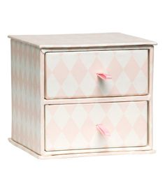 Storage box in patterned cardboard. Two drawers with fabric pulls. Size 4 x 4 1/4 x 4 1/4 in. Drawer height 1 1/2 in.