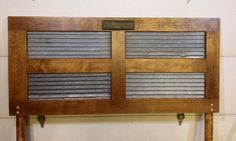 rustic headboard with wood and corrugated tin inlay | Vintage barn corrugated tin siding adds texture to this antique door ...