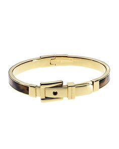 From Michael Kors, this fashion-forward  golden bangle bracelet is accented with buckle hardware and has tortoiseshell pattern detailing adding a signature style to a stackable bangle. Description from reeds.com. I searched for this on bing.com/images