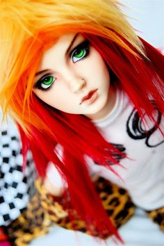 Look at that hair! And those pretty green eyes I love ball jointed dolls tgey are so pretty