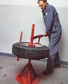 If you live in a remote area without ready access to a professional auto shop, make this manual tire changer and you& be able to swap out punctured or damaged tires yourself. Garage Tools, Car Tools, Reuse Old Tires, Reuse Recycle, Engineering Tools, Tire Swings, Tire Chairs, Damaged Cars, Used Tires