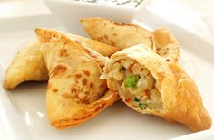 This is a recipe for vegetable samosas. Wonton wrappers are stuffed with a spiced potato and pea mixture and fried until golden brown. Perfect appetizers.